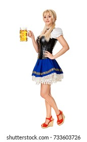 Full length portrait of a blond woman with traditional costume holding beer glasses isolated on white background.