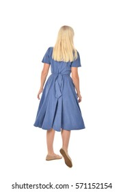 full length portrait of a blonde haired woman wearing a simple blue dress. standing pose with back to the camera, isolated on white background.