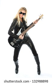 Full length portrait of blonde woman in black costume with guitar