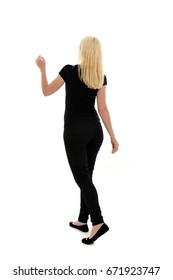 full length portrait of blonde woman wearing simple black clothing, standing pose. isolated on white background.