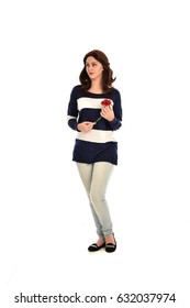 full length portrait of brunette girl wearing jeans and stripped top. isolated against white background.