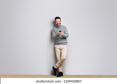 Full length portrait of businessman holding mobile phone