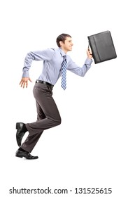 Full length portrait of a businessman running with a briefcase isolated on white background