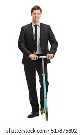 Full length portrait of a businessman with a scooter isolated on white background