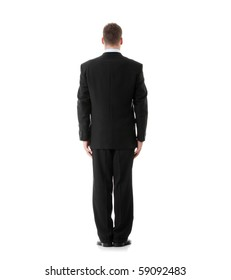 Full length portrait of businessman standing back, isolated