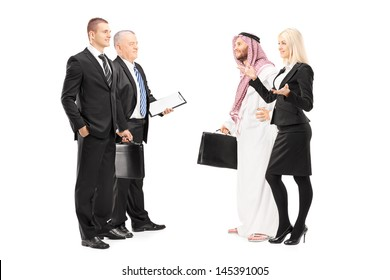 Full length portrait of businessmen and businesswoman having a conversation during a investment meeting isolated on white background