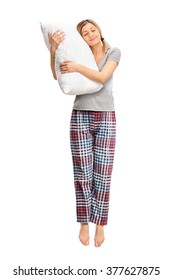 Full length portrait of a calm woman hugging a pillow and sleeping shot in mid-air isolated on white background