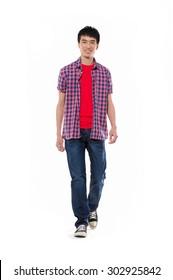 Full length Portrait of casual man in jeanswalking in studio