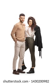Full length portrait of a casual young couple standing and posing isolated on white background