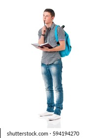 Full length portrait of a caucasian guy carrying some books and a backpack, isolated on white background. Smart  student of college or university writes in a notebook lecture.