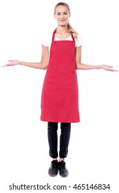 Full length portrait of a charming young female chef.