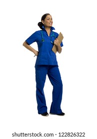 Full length portrait of cheerful female nurse against white background