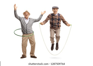 Full length portrait of a cheerful mature man with a hula hoop and a senior man jumping on a skipping rope isolated on white background