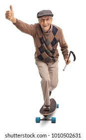 Full length portrait of a cheerful senior riding a longboard and making a thumb up gesture isolated on white background