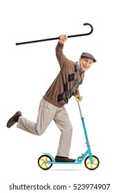 Full length portrait of a cheerful senior riding a scooter and holding a walking cane isolated on white background