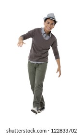 Full length portrait of cheerful teenage guy against white background