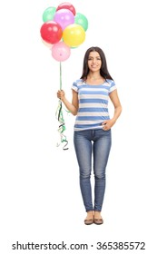 Full length portrait of a cheerful young woman holding a bunch of balloons isolated on white background