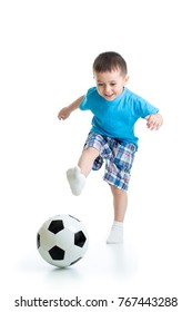 Full length portrait of child boy playing with soccer ball isolated on white background