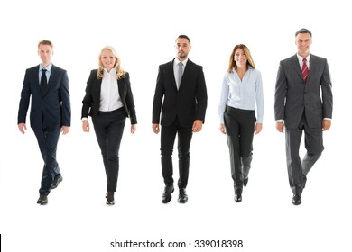 Full length portrait of confident business people walking against white background