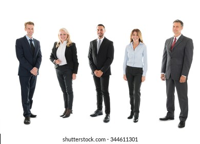 Full length portrait of confident business people standing against white background