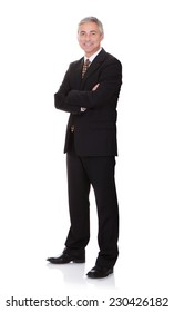 Full length portrait of confident businessman with arms crossed isolated over white background