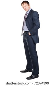 Full length portrait of a confident businessman with hands in pockets, over white background