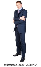 Full length portrait of a confident businessman with crossed arms, over white background