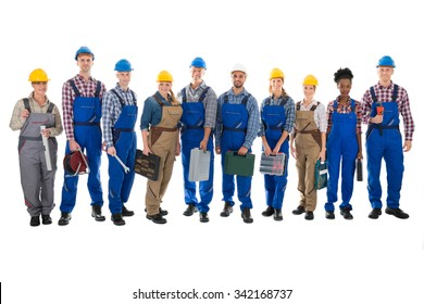 Full length portrait of confident carpenters carrying toolboxes against white background