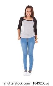 Full length portrait of confident female student standing against white background