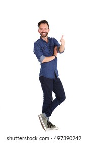 Full length portrait of confident mature man standing and showing thumbs up over white background