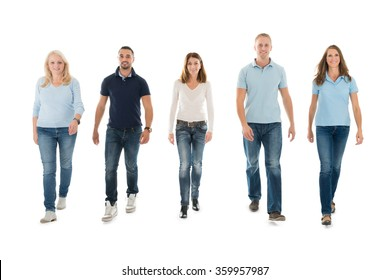 Full length portrait of confident people in casuals walking against white background