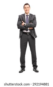 Full length portrait of a confident young businessman in a gray suit looking at the camera isolated on white background