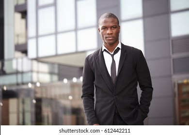 Full length portrait of a confident young businessman walking in the city
