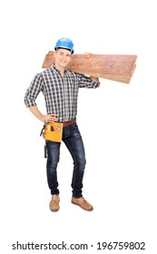 Full length portrait of a construction worker holding a couple of planks isolated on white background