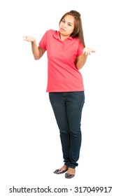 A full length portrait of a cute Asian woman shrugging her shoulders and palms up implying unsure, uncertain, apathetic or I don't know attitude while looking at camera. Vertical