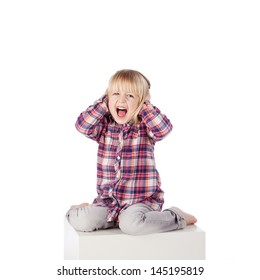 Full length portrait of cute girl shouting while sitting on block isolated over white background