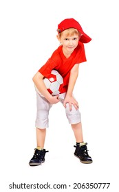 Full length portrait of a cute smiling 7 years old boy with a ball. Isolated over white.