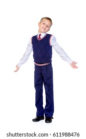 Full length portrait of a cute smiling nine year old boy in a school uniform. Educational concept. Children's fashion. Isolated over white background. Copy space.
