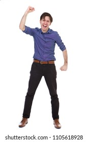 Full length portrait of ecstatic young man standing with fist raised