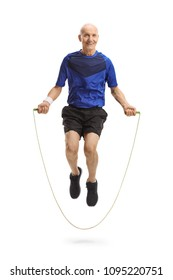 Full length portrait of an elderly man in sportswear exercising with a skipping rope isolated on white background