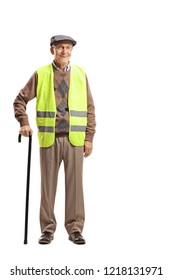 Full length portrait of an elderly man standing with a cane and wearing safety vest isolated on white background