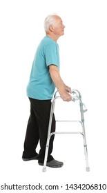 Full length portrait of elderly man using walking frame isolated on white