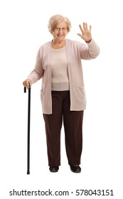 Full length portrait of an elderly woman with a walking cane waving isolated on white background