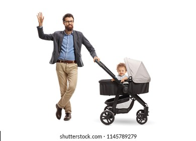 Full length portrait of a father with a baby boy in a stroller waving at the camera isolated on white background