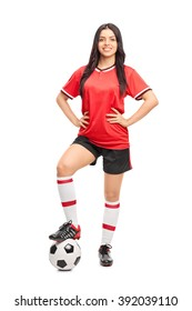 Full length portrait of a female football player in a red jersey isolated on white background