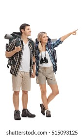 Full length portrait of a female hiker showing something in the distance to a male hiker isolated on white background