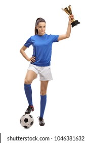 Full length portrait of a female soccer player with a football and a golden trophy isolated on white background