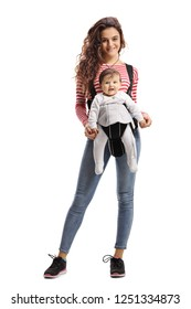 Full length portrait of a fit young mother with a baby in a carrier isolated on white background