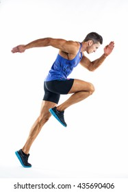 Full length portrait of a fitness man running isolated on a white background.