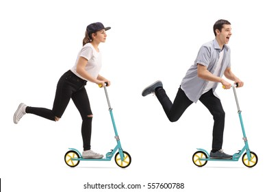 Full length portrait of a girl and a guy riding scooters isolated on white background